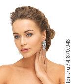 Купить «Красивая молодая женщина с серьгами с драгоценными камнями», фото № 4870948, снято 17 марта 2013 г. (c) Syda Productions / Фотобанк Лори