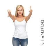 Купить «Девушка подняла один палец вверх, а второй опустила», фото № 4871092, снято 30 марта 2013 г. (c) Syda Productions / Фотобанк Лори