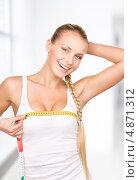 Купить «Красивая стройная девушка с лентой сантиметра в руках измеряет объемы своего тела», фото № 4871312, снято 8 мая 2010 г. (c) Syda Productions / Фотобанк Лори