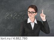 Строгая учительница преподает математику. Стоковое фото, фотограф Darkbird77 / Фотобанк Лори