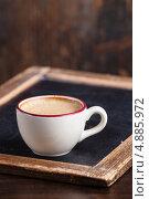 Купить «Чашка кофе на деревянном столе», фото № 4885972, снято 8 февраля 2013 г. (c) Лисовская Наталья / Фотобанк Лори