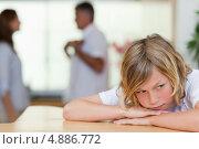 Купить «Грустный мальчик с ругающимися родителями за ним», фото № 4886772, снято 2 ноября 2011 г. (c) Wavebreak Media / Фотобанк Лори