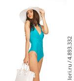 Красивая юная девушка в голубом купальнике и шляпе с широкими полями. Стоковое фото, фотограф Syda Productions / Фотобанк Лори