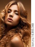 Купить «Сексуальная молодая женщина с русыми волосами на бежевом фоне», фото № 4893348, снято 1 сентября 2011 г. (c) Syda Productions / Фотобанк Лори