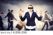 Купить «Бизнес-леди с завязанными глазами на ощупь идет в толпе коллег», фото № 4896096, снято 19 июня 2019 г. (c) Sergey Nivens / Фотобанк Лори