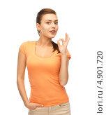 Купить «Красивая и счастливая юная девушка в оранжевой футболке», фото № 4901720, снято 1 июня 2013 г. (c) Syda Productions / Фотобанк Лори