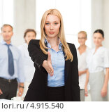 Купить «Счастливая бизнес леди в офисном костюме на фоне коллег», фото № 4915540, снято 13 июня 2013 г. (c) Syda Productions / Фотобанк Лори