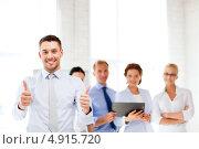 Купить «Успешные деловые коллеги в офисе», фото № 4915720, снято 9 июня 2013 г. (c) Syda Productions / Фотобанк Лори