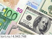 Купить «Фон из евро и долларовых банкнот», фото № 4943748, снято 28 июля 2013 г. (c) Николай Комаровский / Фотобанк Лори