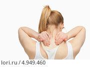 Купить «Вид со спины на девушку, массирующую себе шею», фото № 4949460, снято 5 апреля 2012 г. (c) Wavebreak Media / Фотобанк Лори