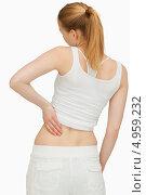 Купить «Вид со спины на девушку, держащуюся рукой за поясницу», фото № 4959232, снято 5 апреля 2012 г. (c) Wavebreak Media / Фотобанк Лори