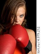 Купить «Агрессивная девушка с красными перчатками для бокса», фото № 4979212, снято 27 июля 2006 г. (c) Syda Productions / Фотобанк Лори
