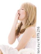Купить «Юная девушка зевает на белом фоне», фото № 4979216, снято 3 января 2009 г. (c) Syda Productions / Фотобанк Лори