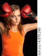 Купить «Агрессивная девушка с красными перчатками для бокса», фото № 4979240, снято 27 июля 2006 г. (c) Syda Productions / Фотобанк Лори