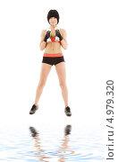 Купить «Юная брюнетка занимается фитнесом на белом фоне», фото № 4979320, снято 29 ноября 2008 г. (c) Syda Productions / Фотобанк Лори