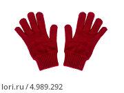 Две красные вязаные перчатки на белом фоне. Стоковое фото, фотограф Сергей Видинеев / Фотобанк Лори