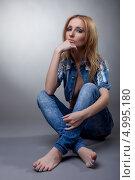 Купить «Задумчивая девушка в джинсовом костюме», фото № 4995180, снято 2 декабря 2011 г. (c) Гурьянов Андрей / Фотобанк Лори