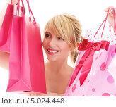 Купить «Красивая молодая женщина с покупками в сумках на белом фоне», фото № 5024448, снято 3 января 2009 г. (c) Syda Productions / Фотобанк Лори