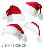 Шапка Санта Клауса, изолированная на белом фоне. Стоковое фото, фотограф Наталья Алексахина / Фотобанк Лори