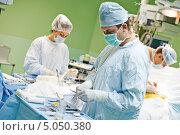Команда врачей на операции. Стоковое фото, фотограф Дмитрий Калиновский / Фотобанк Лори