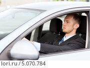 Купить «Молодой водитель за рулем автомобиля», фото № 5070784, снято 26 июня 2013 г. (c) Syda Productions / Фотобанк Лори
