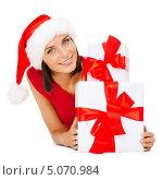 Купить «Счастливая девушка в шапке Санты с многочисленными подарками на Новый год», фото № 5070984, снято 15 августа 2013 г. (c) Syda Productions / Фотобанк Лори