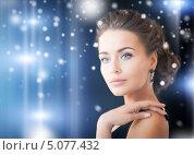 Купить «Красивая молодая женщина в элегантном вечернем платье», фото № 5077432, снято 17 марта 2013 г. (c) Syda Productions / Фотобанк Лори