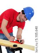 Купить «Столяр работает рубанком», фото № 5105640, снято 4 марта 2011 г. (c) Phovoir Images / Фотобанк Лори