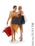 Купить «Две подруги с покупками в пакетах на белом фоне», фото № 5111736, снято 19 августа 2006 г. (c) Syda Productions / Фотобанк Лори