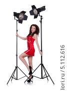 Купить «Девушка в красном платье с софитами», фото № 5112616, снято 7 февраля 2013 г. (c) Elnur / Фотобанк Лори