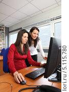 Купить «Девушка за компьютером рядом с коллегой», фото № 5115780, снято 12 февраля 2010 г. (c) Phovoir Images / Фотобанк Лори
