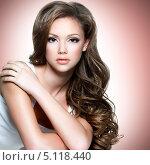 Купить «Портрет красивой молодой девушки с длинными волосами на розовом фоне», фото № 5118440, снято 1 ноября 2010 г. (c) Валуа Виталий / Фотобанк Лори