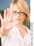 Купить «Строгая девушка в очках показывает жест стоп», фото № 5127416, снято 28 июня 2009 г. (c) Syda Productions / Фотобанк Лори