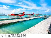 Гидросамолет в аэропорту Мале, Мальдивские острова (2012 год). Редакционное фото, фотограф Aleksandr Stzhalkovski / Фотобанк Лори