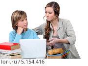 Купить «Молодая учительница с учеником», фото № 5154416, снято 21 декабря 2010 г. (c) Phovoir Images / Фотобанк Лори