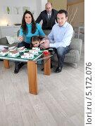 Купить «Семья в офисе архитектора», фото № 5172076, снято 21 января 2010 г. (c) Phovoir Images / Фотобанк Лори
