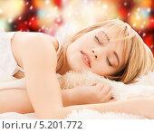 Купить «Юная девушка сладко спит в кровати», фото № 5201772, снято 3 января 2009 г. (c) Syda Productions / Фотобанк Лори
