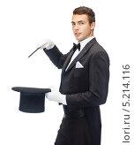 Купить «Молодой человек во фраке показывает фокусы», фото № 5214116, снято 12 сентября 2013 г. (c) Syda Productions / Фотобанк Лори