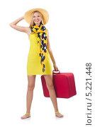 Купить «Девушка в желтом платье держит красный чемодан и улыбается», фото № 5221448, снято 5 сентября 2013 г. (c) Elnur / Фотобанк Лори