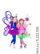 Купить «Две девочки в карнавальных нарядах на белом фоне», фото № 5222936, снято 22 мая 2013 г. (c) Сергей Сухоруков / Фотобанк Лори