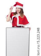Купить «Девушка в красном новогоднем костюме держит пустой банннер», фото № 5223248, снято 24 августа 2013 г. (c) Elnur / Фотобанк Лори