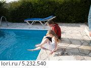Купить «Две сестры около бассейна», фото № 5232540, снято 24 марта 2012 г. (c) Darja Vorontsova / Фотобанк Лори