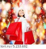 Купить «Счастливая девушка с подарками в разноцветных пакетах», фото № 5233692, снято 15 августа 2013 г. (c) Syda Productions / Фотобанк Лори