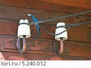 Купить «Изоляторы на стене дома», эксклюзивное фото № 5240012, снято 9 июля 2010 г. (c) Алёшина Оксана / Фотобанк Лори