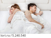 Купить «красивая молодая пара спит в кровати», фото № 5240540, снято 21 апреля 2013 г. (c) Андрей Попов / Фотобанк Лори