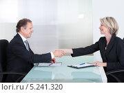 Купить «деловые партнеры за столом переговоров заключают сделку», фото № 5241320, снято 26 мая 2013 г. (c) Андрей Попов / Фотобанк Лори