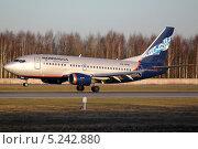 Boeing 737-500 Нордавиа совершает посадку. Редакционное фото, фотограф Олег Пластинин / Фотобанк Лори