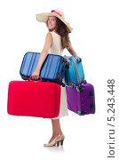 Купить «Молодая женщина держит четыре чемодана», фото № 5243448, снято 29 августа 2013 г. (c) Elnur / Фотобанк Лори