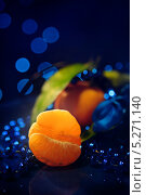 Купить «Мандарины на тёмно-синем фоне», фото № 5271140, снято 14 ноября 2013 г. (c) Анастасия Кононенко / Фотобанк Лори