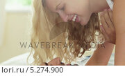 Купить «Cute young couple lying on the bed and kissing», видеоролик № 5274900, снято 22 июля 2019 г. (c) Wavebreak Media / Фотобанк Лори